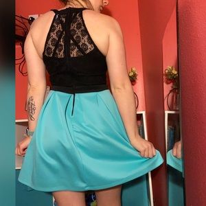 A black and turquoise dress